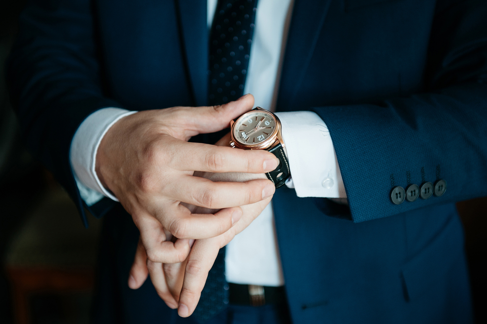 guy checking watch shutterstock 398159059